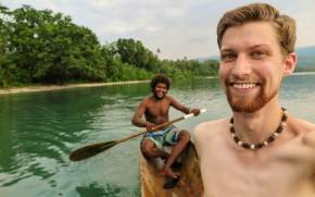 Matthew Bond, Ph.D student in botany at the University of Hawai'i at Mānoa. Collecting aquatic medicinal plants in a dugout canoe, Malaita Island, Solomon Islands. Mathew Bond studies how people know and choose medicinal plants.